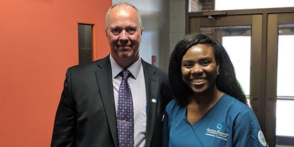 Anoka-Ramsey Community College President Kent Hanson and Nursing student Sarah Richardson